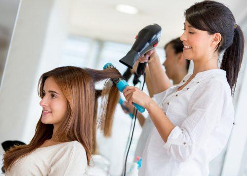 hair stylist working in salon
